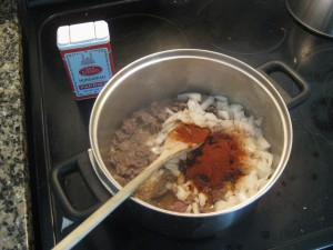 making goulash: add paprika
