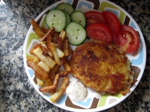 fried cheese with fries, cucumbers and tomatoes