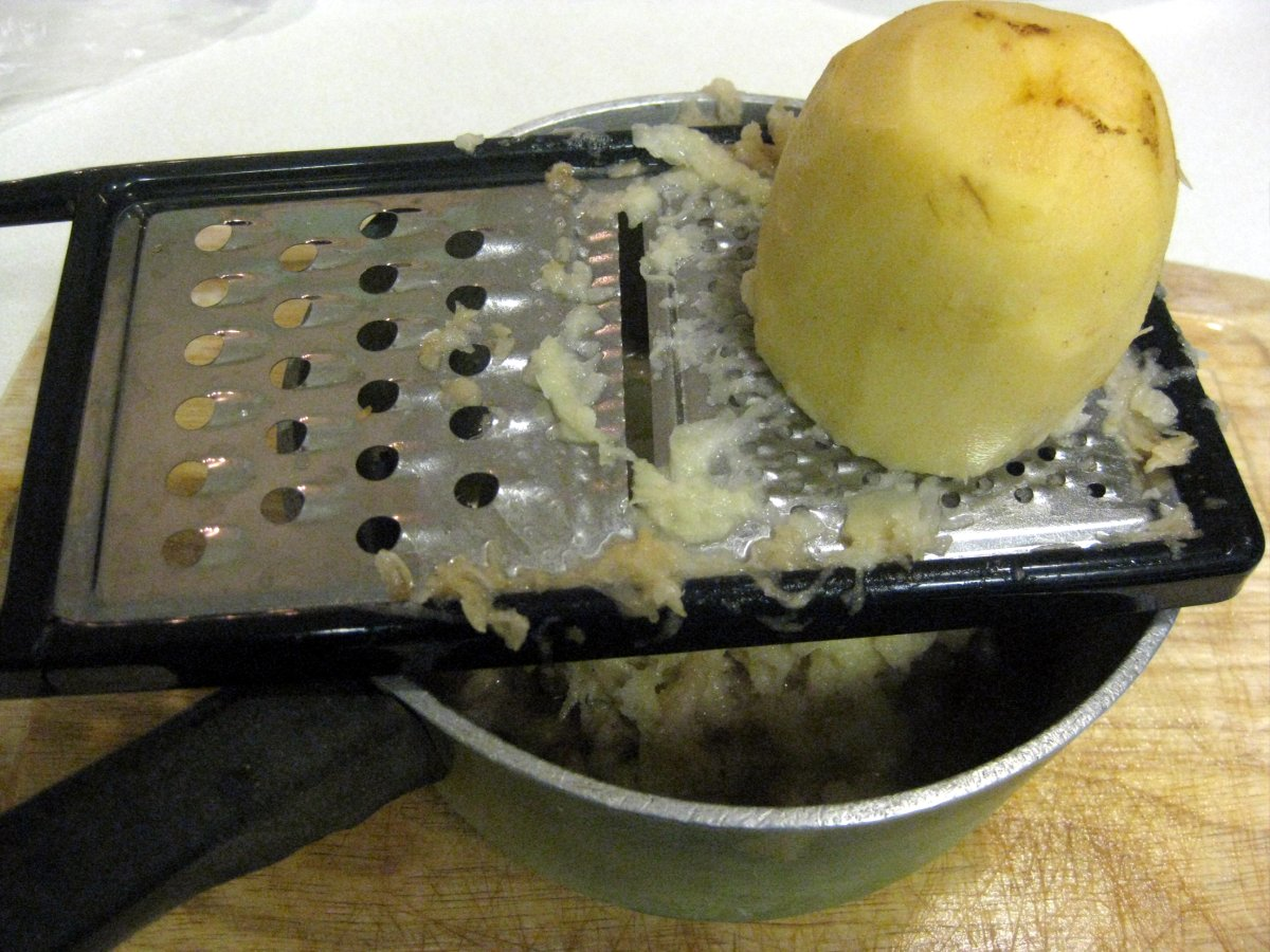 Food Processor Shredding Potatoes