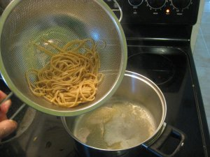 combine spaghetti with melted butter