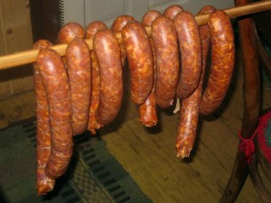 sausages hanging from a stick