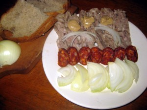 Slovak tlacenka or pressed meat with smoked sausage and onions