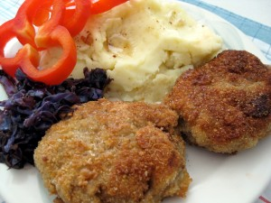 Slovak fried meat hamburger pattie fasirka served with mashed potatoes, red cabbage and vegetables