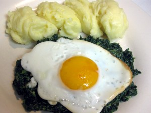 spinach with fried egg and mashed potatoes