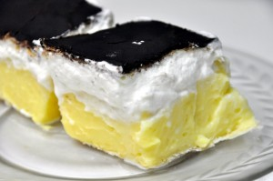 slovak kremes puff pastry with cream and custard topped in chocolate