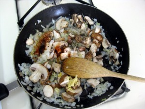 onions mushrooms bacon frying on oil