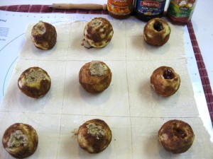 puff pastry dough cut into squares with stuffed apples