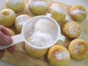 dusting donuts with sugar