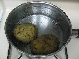 potatoes boiling in their skin