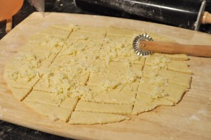 cheese bread dough covered with grated cheese