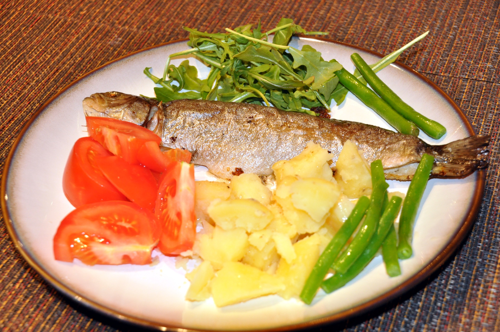 whole trout baked on butter with potatoes and vegetables