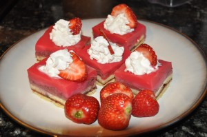decorated strawberry pudding cake with whipped cream