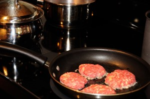 frying meat patties